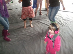 toddler in dance tent