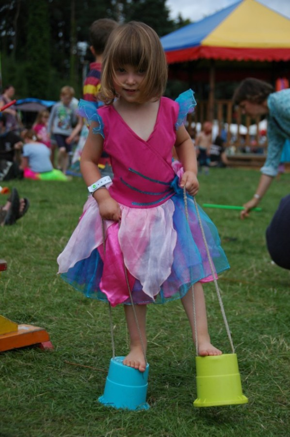 Toddler on stilts in the kids field
