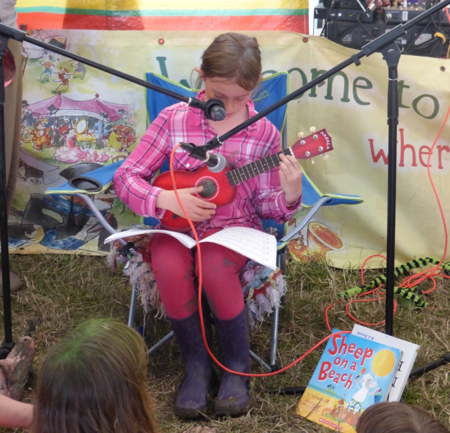 My daughter Eloise playing ukulele at Truck festival