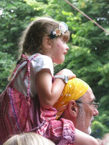 girl on shoulders at Larmer Tree Festival 2018