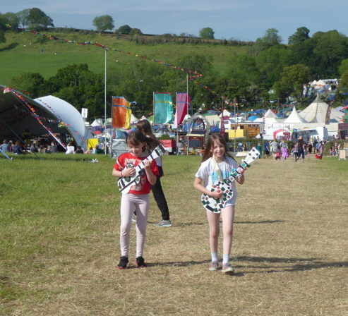 Shindig Festival 2019 girls playing cardboard guitars